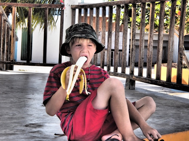 Our Little Popeye Eating a Banana